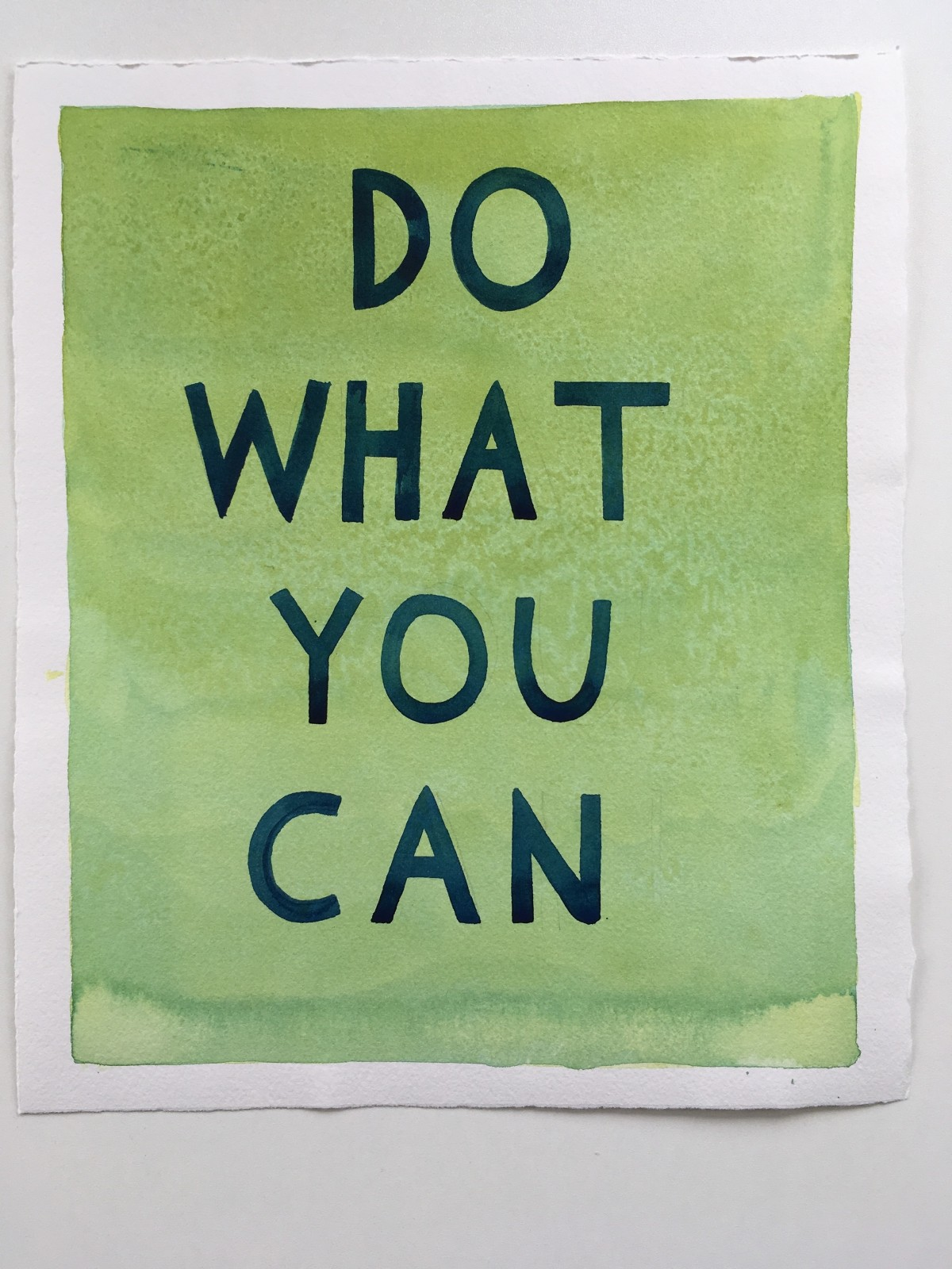 "Hand-lettered ""Do What You Can"" on green watercolor background"