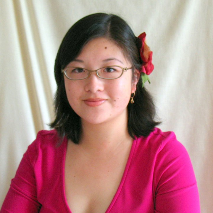 Young Asian woman with glasses, a red flower in her hair