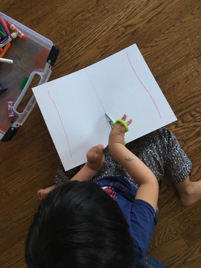Toddler using scissors