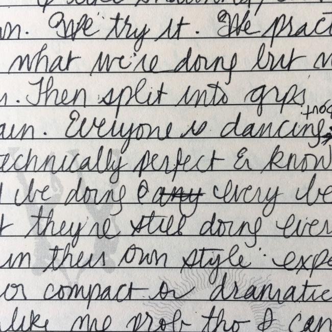 Handwritten text on light-brown ruled paper