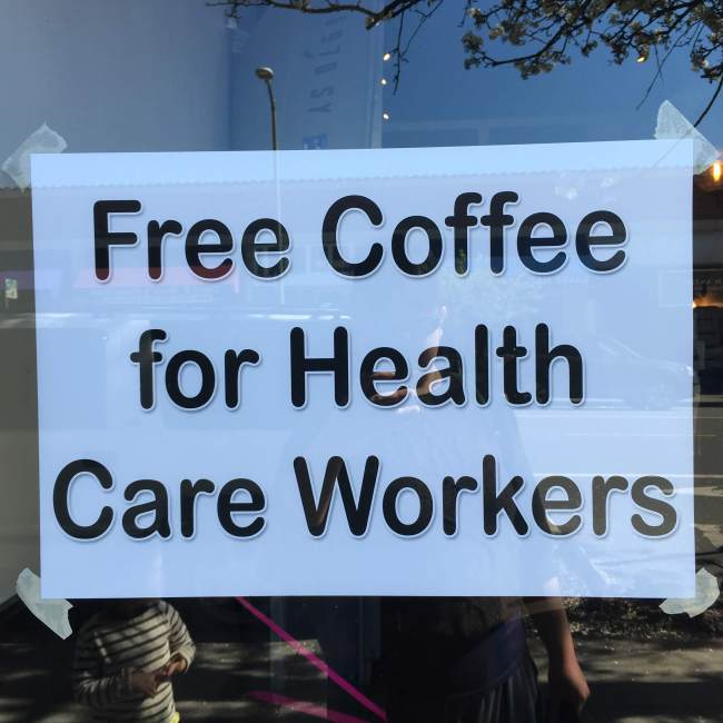"Typed sign in a cafe window: ""Free Coffee for Health Care Workers"""