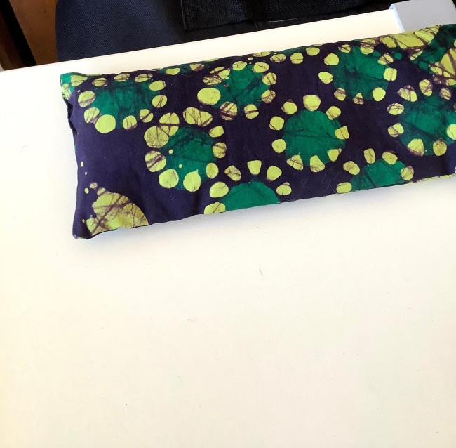 Dark blue eye pillow with wax print of dark and lighter green circles