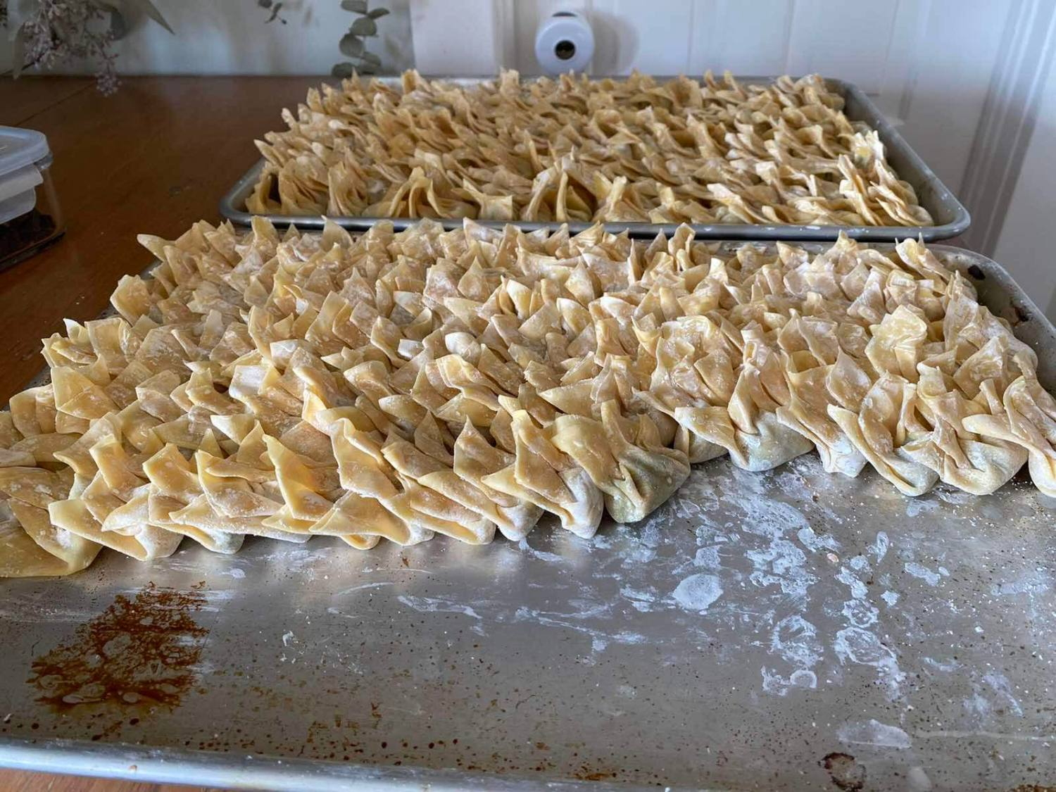 Two baking trays of wontons