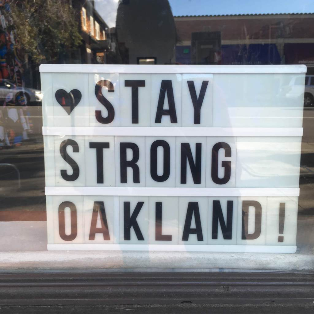 Window sign reading STAY STRONG OAKLAND